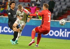 Andras Schafer (centre) nods home Hungary's second goal.