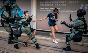 Police chase down a couple wearing face masks in Hong Kong last week