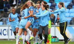 Manchester City Women players celebrate as they win the WSL title by beating Chelsea Ladies FC 2-0.