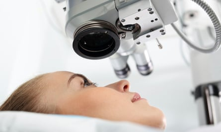 Eye doctor during the treatment of vision refractive surgery