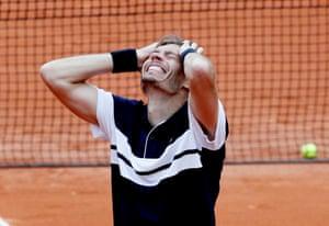Mahut celebrates winning his first round match against Cecchinato.