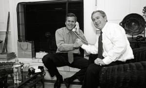 George Bush celebrates with his brother Jeb after news arrives that Florida has been won.