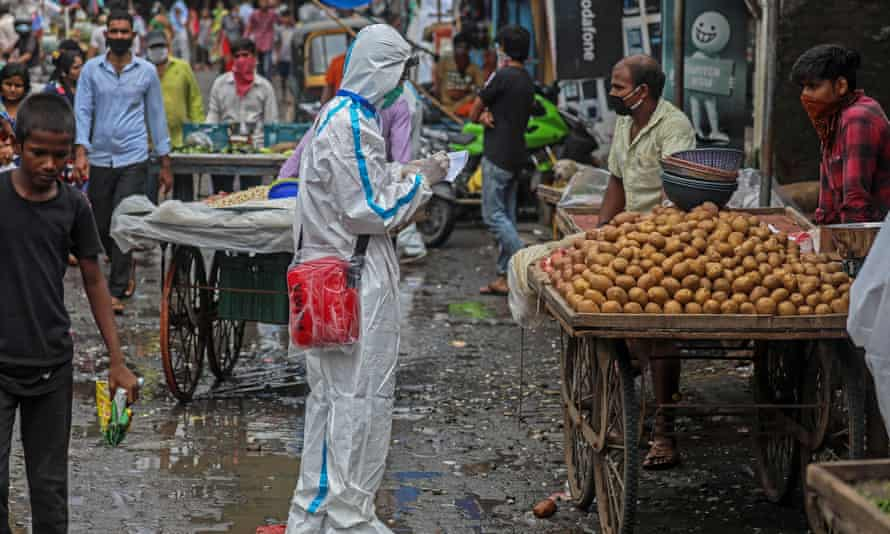 Indian health workers carry out a medical checkup of the vendors  in Ambujwadi, a Covid-19 hotspot, in Mumbai.