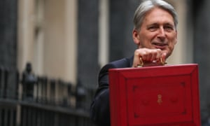 British chancellor of the exchequer Philip Hammond with the budget box as he leaves Downing Street in London.