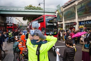 Environmental activists from Stop Killing Londoners and Mums for Lungs block Brixton Road at rush hour.