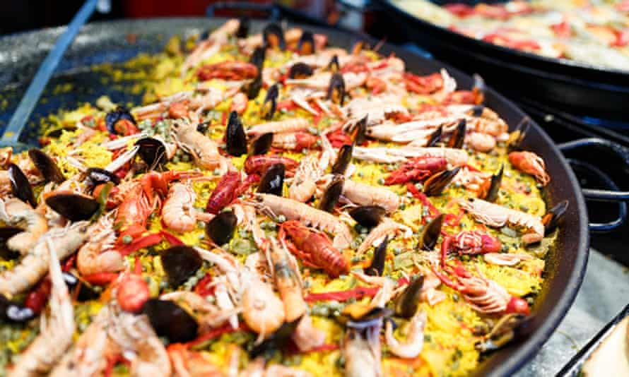 paella, yellow rice, mussels and seafood