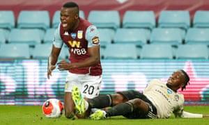Manchester United's Aaron Wan-Bissaka fouled Mbwana Samatta of Aston Villa.