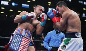 Keith Thurman catches Josesito Lopez with un uppercut during the eighth round.