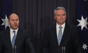 Josh Frydenberg and Mathias Cormann in front of Australian flags