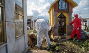 A crew of municipal pantheon workers carry out work to bury a woman who died of Covid-19 in Coatepec, Veracruz, México, 7 Jun 2020.