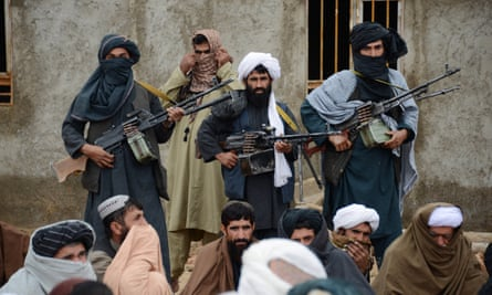 Afghan Taliban fighters listen to Mullah Mohammed Rasool, the newly-elected leader of a breakaway faction of the Taliban, in Farah province, Afghanistan.