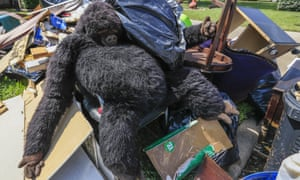 A stuffed gorilla lies on a pile of flood debris in an east Houston neighborhood in the wake of tropical storm Harvey.
