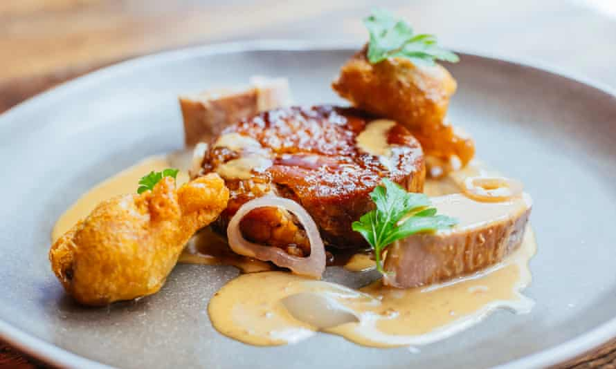 'Bubbled pieces of battered black pudding shatter between the teeth': braised pork collar.