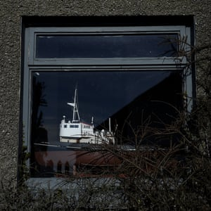 A model of a trawler is displayed in the window of a house in Sunderland Point, Morecambe Bay
