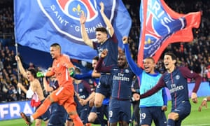 PSG's players celebrate on the pitch after clinching their fifth Ligue 1 title in six seasons.