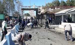 Officials inspect the scene of the attack in Chabahar