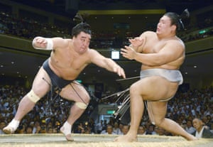 Harumafuji, left, fights Takanoiwa in the ring in September 2016.