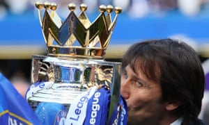 Antonio Conte kisses the Premier League trophy after winning the title in his first season in England.