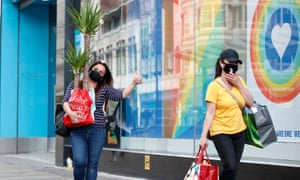 Shoppers on Market Street in Manchester, as non-essential shops in England open their doors