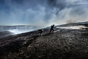 Manchester, UK: Firefighters tackle a wildfire on Saddleworth Moor