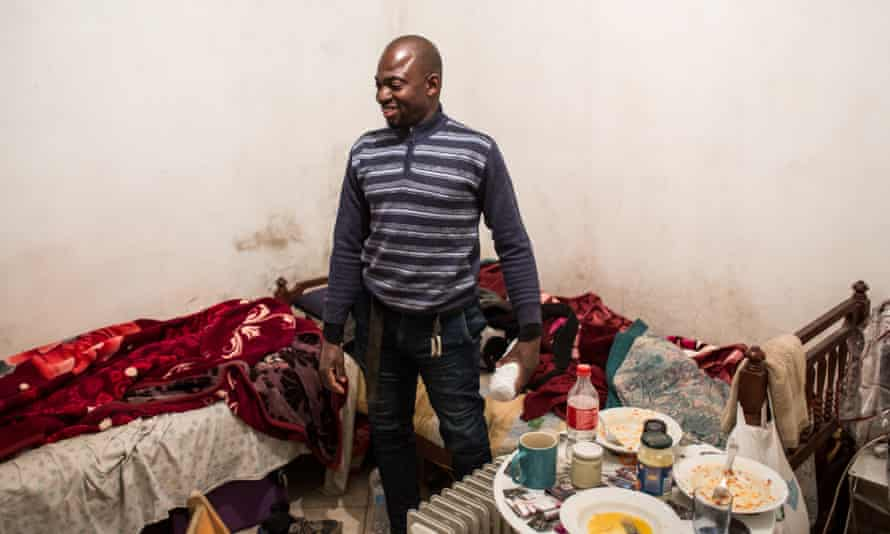 Modibo in the bedroom of his house in Rome