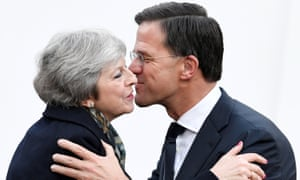 Theresa May is welcomed by Mark Rutte in The Hague in December last year