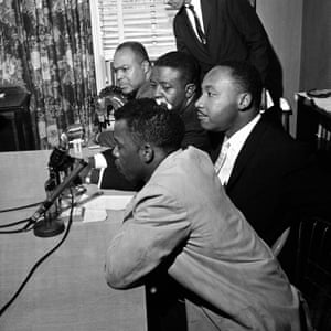 A news conference in Montgomery, Alabama, in 1961. In the foreground is John Lewis. Others, left to right: James Farmer, the Rev Ralph Abernathy and the Rev Dr Martin Luther King Jr.