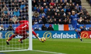 Crystal Palace keeper Julian Speroni makes a save from Leicester City's Riyad Mahrez.