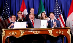 Enrique Peña Nieto, Donald Trump and Justin Trudeau at the signing ceremony in Buenos Aires, Argentina, on 30 November.