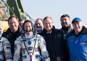 Tim Peake and Jan Woerner (front centre), the European Space Agency director general, walk to the launchpad