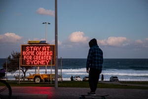 A social distancing sign at Bondi Beach reminds people that Sydney is in lockdown.