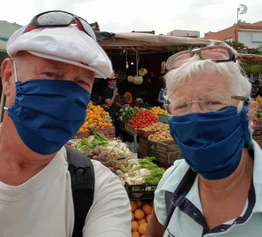 Andy and Shelia enjoying one of the 'pleasures of Morocco' buying fruit and veg at the market after the country decreed those not wearing masks risked prison.