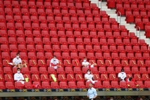 Mainz' players observe social distancing in the stands during the German first division Bundesliga football match Mainz 05 v RB Leipzig in Mainz, western Germany, on May 24, 2020.