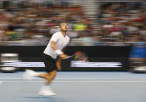 Dan Evans runs to play a shot.