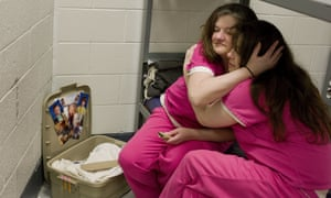 Crystal French, 38, left, is comforted by cellmate Krystle Sweat, 32