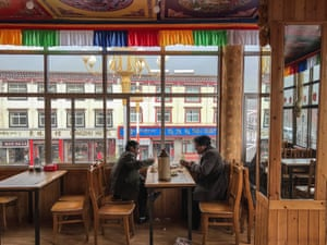 Ethnic Tibetan men have their lunch in the Tibetan restaurant near the Labrang Monastery in Xiahe, an ethnically-Tibetan town in Gansu province, China