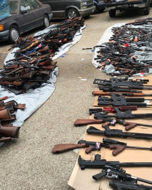 More than 1,000 guns and piles of ammunition were seized from a mansion in Los Angeles.