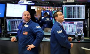 Traders work at the New York Stock Exchange in New York on 26 December.