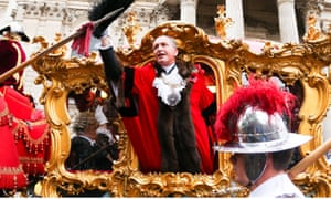 Charles Bowman waves at the crowds at the Lord Mayor's show