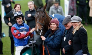 Paisley Park after the Cleeve Hurdle with jockey Aidan Coleman and owner Andrew Gemmell