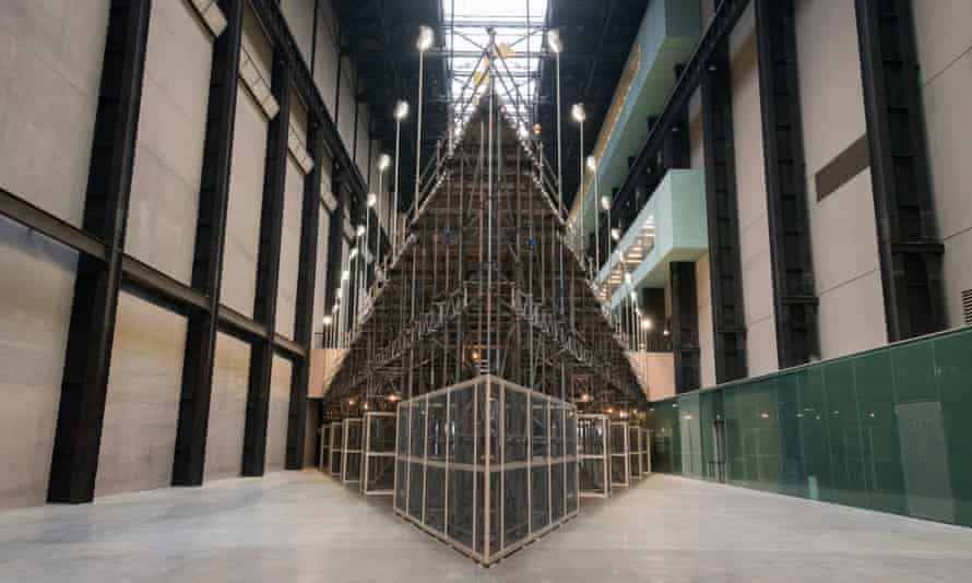 The artwork is held in place by scaffolding