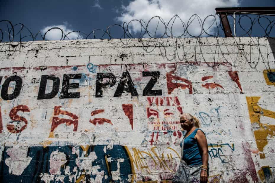A political mural shows the eyes of former President Hugo Chavez