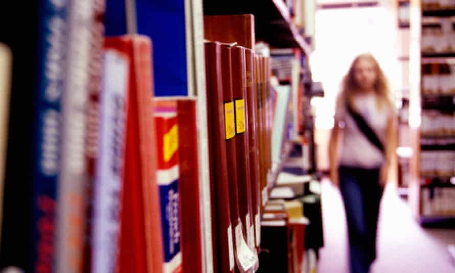 Student walking in library