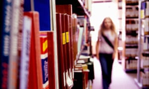A girl walking in a library