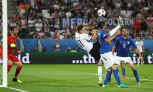 Julian Draxler improvises an overhead kick,which goes just over Buffon's bar.