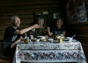 """Alexey Vasilyev (Russia) Sakhawood.  Sakhawood takes us behind the scenes of Yakutia's remarkable independent film industry. Stepan (on the left) drinks cognac at home with screenwriter Semyon Ermolaev (on the middle) and Eduard Novikov (on the right), the creators of the feature film """"The Lord Eagle"""", which won the Grand Prix of the Moscow International Film festival in 2018."""