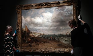 Staff at Brighton Museum & Art Gallery hang a Constable oil for the new exhibition.