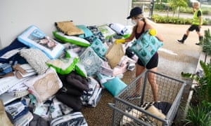 Workers clean up at an Idalia shopping centre