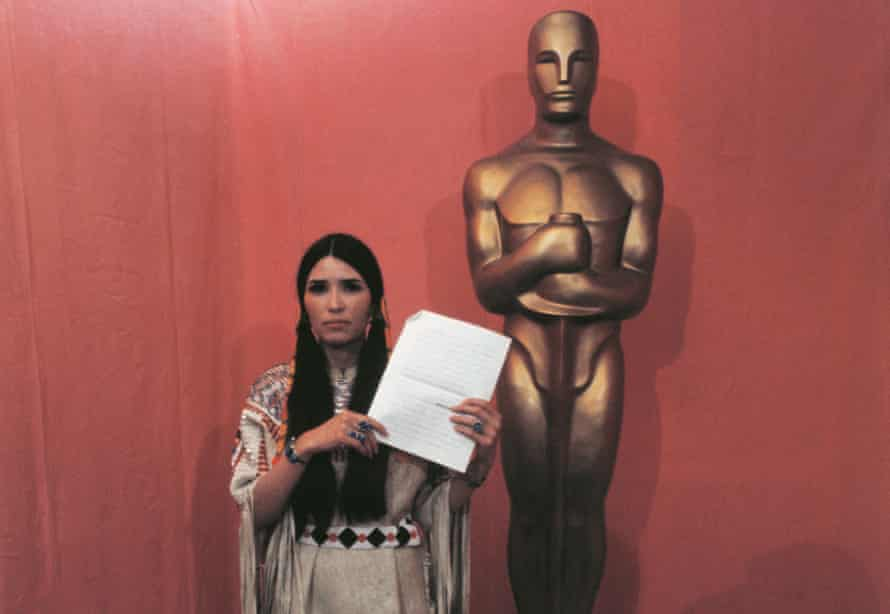Sacheen Littlefeather at the 1973 Oscar ceremony with Marlon Brando's 15-page statement.
