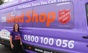 Jodi Hoare, the Good Shop project manager, next to the distinctive purple van in Auckland.